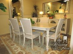 "Gorgeous Ashley dining table in a light, aged parchment finish with six matching chairs. The chairs are upholstered in a soft taupe with nailhead trim. 66""L x 44""W; 18""Lf. Currently retails for just over $1,100 new!"