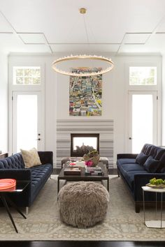 Contemporary Living Room by Ann Lowengart Interiors. Sofas facing each other banked by fireplace and tv