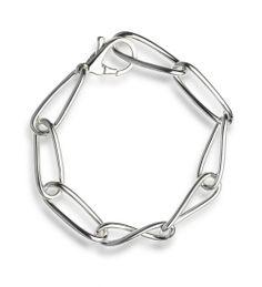 Käsintehty Ikuisuus rannekoru, suunnitellut Pekka Piekäinen. Handmade bracelet, designed by Pekka Piekäinen