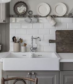 DOMSJÖ Double bowl apron front sink, $312.98 from IKEA. Absolutely the best price you'll find for an apron-front sink, especially a porcelain one.