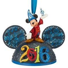 Fully sculptured ear hat ornament with Sorcerer Mickey figurine topper Glitter accents Dimensional ''2016'' logo Internal LED lights change logo through a rainbow of colors On/Off switch Satin ribbon