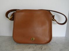 9d8881ae9b00 1970s Coach Large Saddle Bag    Russet Leather Cross Body Bag