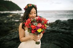 Gorgeous vibrant red, pink, and yellow bridal bouquet + floral crown - Hana, Hawaii Beach Wedding -- Anna Kim Photography
