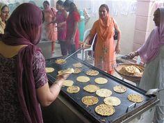 Sikh women make bread for their annual festival