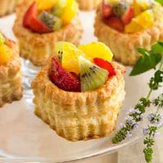 Using puff pastry shells allows you to make these bakery-style desserts in under an hour. The shells are filled with an silky orange cream that's topped with fresh fruit...delicious!