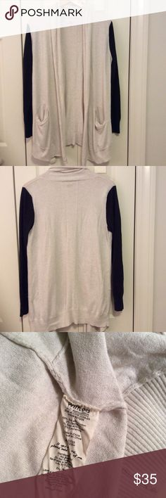 Aritzia Wilfred Cardigan This Wilfred cardigan is in gently used condition. It's very soft and is made, in part, of cashmere and silk. It has two pockets and is a cream and dark gray color.There is some slight pilling. The last picture shows what the pilling is like under the arms. Length 32. From a smoke free, pet friendly home. No trades. Aritzia Sweaters Cardigans