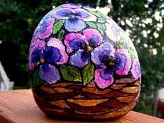 Painted garden rocks..such a great touch of whimsey for the yard or patio..