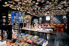 COOK & BOOK, BRUSSELS Shoppers can feast on words as well as food at this inventive bookshop in Brussels. Designed by interior architecture firm Delacroix & Friant, the store is spread over two buildings and divided into nine uniquely decorated sections, each with its own dining area. Books appear to hover above the black-and-red fiction department, while an Airstream is the centerpiece of the travel area. Place du Temps Libre 1, Brussels; cookandbook.be