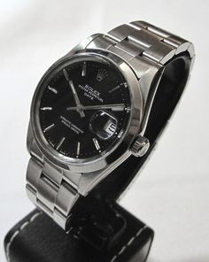 Rolex Datejust with black face: Understated, elegant, just enough sport, ultra-reliable, versatile...perfect.