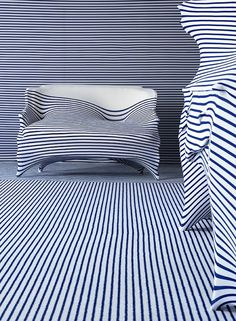 A Roche Bobois sofa and bergère in striped Lycra, 2004 Courtesy of Roche Bobois5. Jean Paul Gaultier's collaboration with Dutch designer Jurgen Bey for Elle Décoration. A Roche Bobois sofa and bergère cocooned in striped Lycra, 2004.