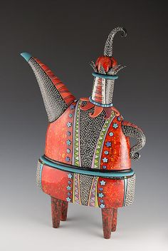 Natalya Sots, ceramics artist originally from Pavlodar, Kazakhstan now living in Chicago. She got started as an artist in high school when she worked at a ceramics factory where she decorated the dishes before they were glazed and fired. She continued this work while attending college. Teapot prices range from $295.00 to $975.00 as of Dec.2014.