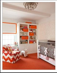 Pink white and orange baby room for a girl with a nursery chair upholstered in orange and white chevron fabric. These photos are full of modern orange baby room ideas for moms decorating a nursery for a baby girl or boy.  This particular nursery features touches