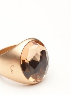 This ring from the Narciso Collection is both classic and playful as it remains the perfect cocktail ring. The ring displays a faceted rock crystal set over 18kt rose gold giving the illusion of a peachy toned stone. The shank is 18kt matte rose gold. Size 52
