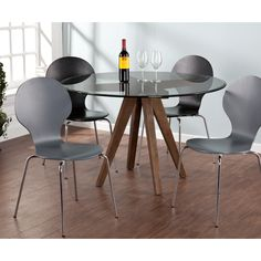 An elegant beveled edge, round glass top and solid wood, burnt oak base combine to form a pedestal table perfect for chic, eclectic decor. The architectural design draws attention to the framework while the glass top creates a floating edge.