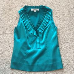 Silk Tank top Teal, silk, Nine West tank top with a ruffle collar and side zipper! In great condition!! Nine West Tops Blouses