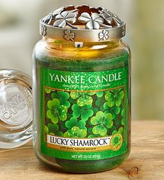 "Feel surrounded by the luck of the Irish with this green"" Lucky Shamrock"" Yankee Candle which is paired with a decorative shamrock Illuma-Lid and will fill your room with a garden-fresh fragrance."
