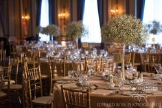Fairmont Palliser - Crystal Ballroom Gold Chiavari chairs Champagne linens from #CelebrationCreationLinenRentals Centerpieces of gypsophilia (baby's breath) in tall Eiffel Tower vases by #CreativeWeddingsFloralDesigns; design by #CreativeWeddingsPlanning&Decor (Photo courtesy of #EdwardRossPhotography)