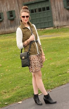 New outfit from Kimberly (NY) - cargo vest,gold aviator sunglasses, Leopard-print dress, waffle knit sweater, belt black leather, wedge booties, black leather crossbody bag - see more on http://www.fashbo.com