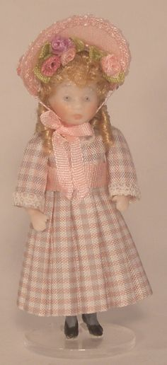 """Lee Silverstein, Laura Collum - 2 1/16"""" Antique Reproduction Porcelain Doll, porcelain work done by Lee, wigging and costuming by Laura; sold on Swan House Miniatures for $199.75"""