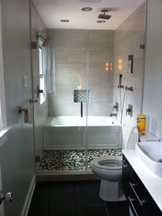 Existing Set up - remove wall - Have Freestanding Tub w/in Shower enclosure - use glass to keep space visually open. (Keep floor tile same to extend)