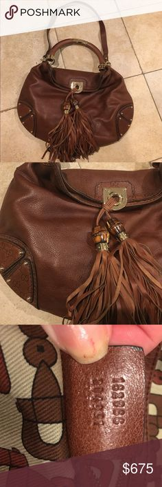"""AUTHENTIC GUCCI INDY BROWN LEATHER SHOULDER BAG AUTHENTIC GUCCI. STYLE """"INDY"""" BAG. BROWN LEATHER BAMBOO TASSEL. LARGE HOBO BAG. MINT CONDITION GOLD HARDWARE. DATE CODE INCLUDED. NO DUST BAG. VERY BIG. CAN BE CARRIED OVER THE ARM OR THERE IS A LONGER STRAP TO GO OVER SHOULDER. ADJUSTABLE STRAP CAN BE REMOVED. MONOGRAM GG ON THE SIDES AND ON THE STITCHING. MORE PICTURES UPON REQUEST. INSIDE MINT CONDITION. CAN DO BETTER ON 🅿 Gucci Bags Shoulder Bags"""