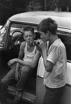 """Leatherwood, Kentucky, """"Cornett boys smoking by car."""" My grandma was a Cornett.I bet those boys wish they had never picked up smoking. Old Pictures, Old Photos, Old Photographs, La Haine Film, Vintage Photography, Street Photography, Photography Kids, Photography Lighting, Photography Website"""
