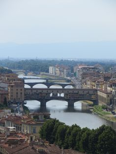 Bridges over the River Arno in Florence.  The Ponte de Oro or Ponte Vechhio shown foremost.   Could spend hours in the bridge looking at the gold jewelry in the multitude of shops!