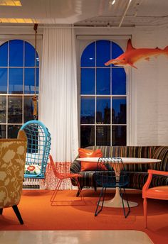 suspended chairs and orange sharks in these funky  law offices // The Axiom Law Offices by BHDM Design