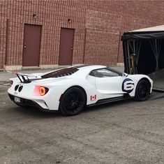 The Ford GT first captured the hearts and minds of many drivers around the world in the A mid-engine, two-seater sports car produced by Ford Mustang, Dream Car Garage, Ford Lincoln Mercury, Ford Gt40, Racing Stripes, Performance Cars, Car Ford, Twin Turbo, American Muscle Cars