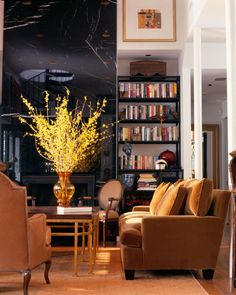 really love that yellow bouquet and camel colored furniture.