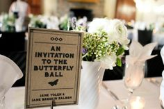 Tables named after bride and groom's favorite books. Cate Jackson Photography www.catejacksonphoto.com