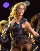Fierce! Beyonce in a Rubin Singer black leather-and-lace bodysuit and over the knee high stockings with stiletto boots.