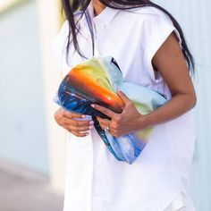 Another great pouch! 50 Inspiring Street Style Outfits To Try For Summer via @Who What Wear