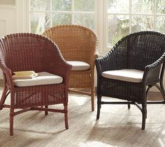 """Wickford Dining Chair - This chair is woven from rattan with a comfortably curved back and gently flared arms that invite you to settle in. Pair with a cushion. 25.5""""W x 24""""D x 34""""H #potterybarn"""