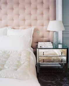 Champagne tufted headboard.