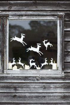 Reindeers by the window. Maybe use Cricut machine.