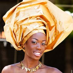 Huge african head wrap hairstyles 2015 --it's definitely an art, and love the sheen of the fabric