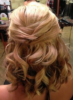 Hmm... I wonder if I should get some extra white stephanotis from the florist for this hair style. Bridal updo for short or medium length hair. Half up wedding style.