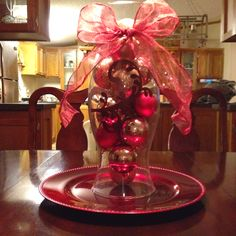 Centerpiece made with a hurricane globe used in our wedding and Christmas ornaments!