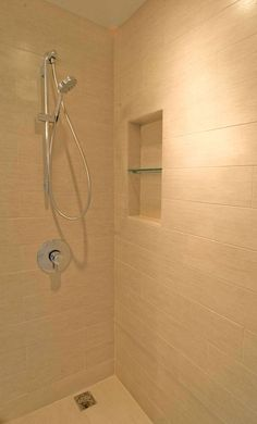 Wood tile pebble rock shower floor yes master bath - How to put down tile in bathroom ...