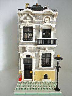 "LEGO Moc Modular ""Al Capone has left the building"" by Jotabeeeee.  Holy smokes, what a great idea to use the printed bricks!!!  Wow, look at all the cool architectual details too.  What a great house."