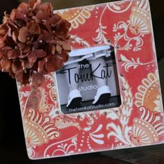 A collection for the wall in the kitchen.. mix candid photos, mirrors and phrases?  Hobby lobby.