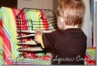 turn a dish drying rack on its side and you've got strife for your toddler's wooden puzzles!!