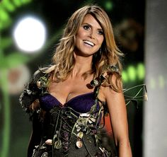 9721207fc4 It s official  Heidi Klum is done with lingerie modeling. In an interview  with Access Hollywood this week