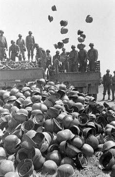 Photo after Axis Surrender in circa 10 May 1943.Piles of German Helmets surrendered