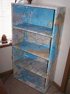 decoupage map bookcase (i would like it better if it were different colored maps)