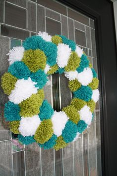 I guess it's my childhood that is drawing towards this wreath. Love pom poms. I'm going to try and make one for my laundry room door.