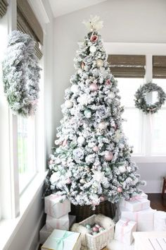 This pastel Christmas decor in the sunroom just goes to show that you don't have to stick to a traditional color scheme to be festive during the holidays! Get inspiration for your own holiday decorating in this post! Christmas Staircase Decor, Christmas Bedroom, Christmas Home, Christmas Trees, Christmas 2019, Christmas Crafts, Christmas Tablescapes, Christmas Mantels, Rustic Christmas