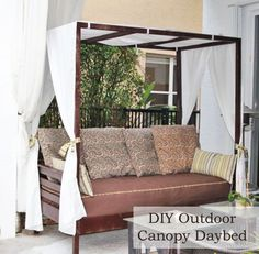 DIY Outdoor Canopy Daybed made out of a twin mattress!  I'm saving this post for when my kid wants her twin bed upgraded one day.