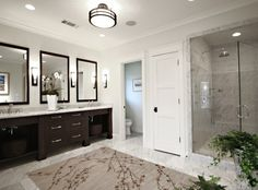 Just to illustrate preference for double sink, toilet separated with a door, and large shower area. Who has a bathroom this bigggg??